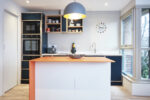 Contemporary Ply Edge Kitchen in Blue, Grey and Orange